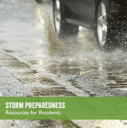 Car driving in the rain. Link to STORM PREPAREDNESS webpage