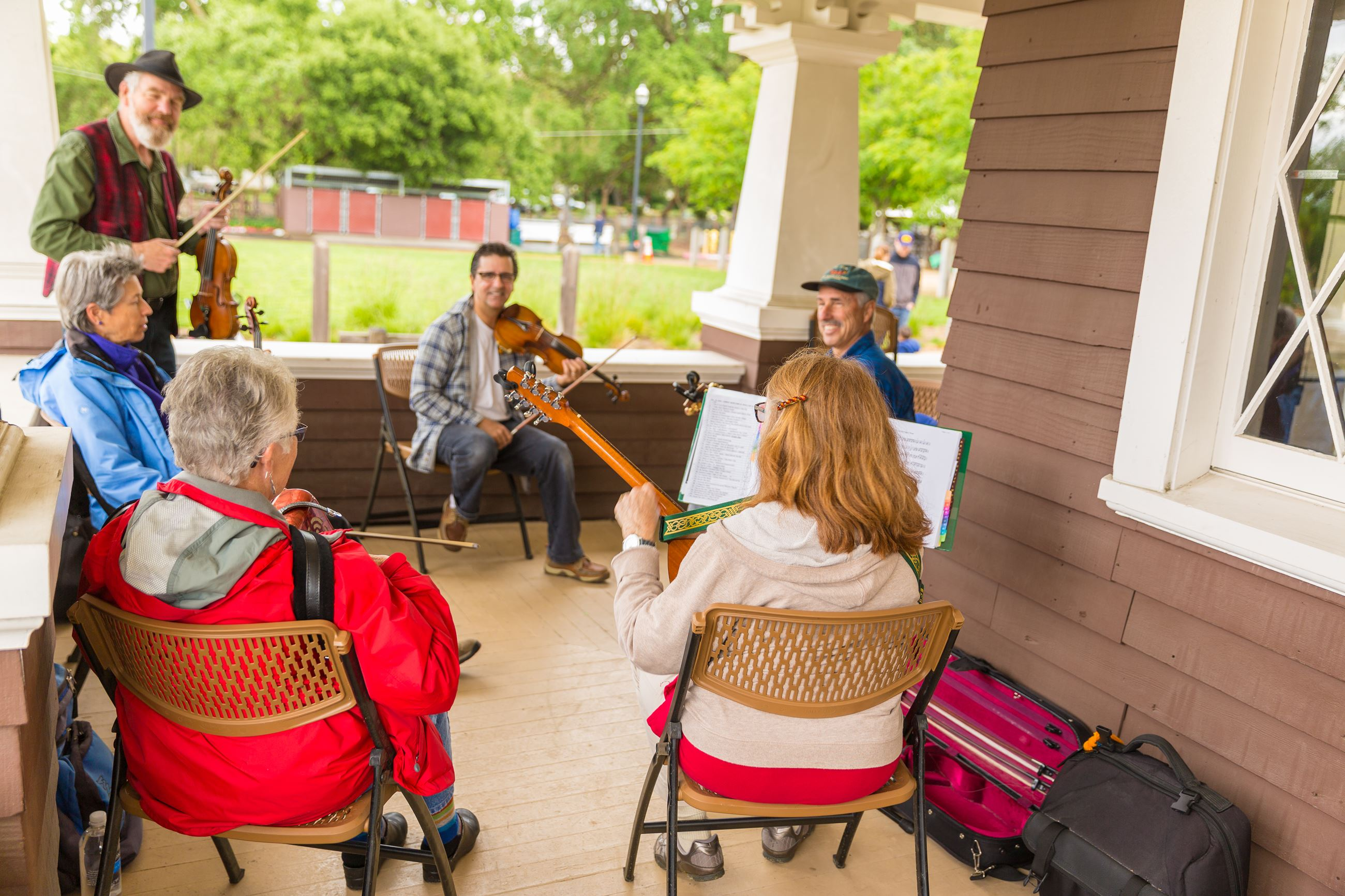 Musicians on the porch of the Kolb House playing music