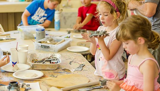 Children working with clay at summer camp