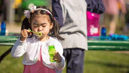 Girl blowing bubbles at Spring Eggstravaganza
